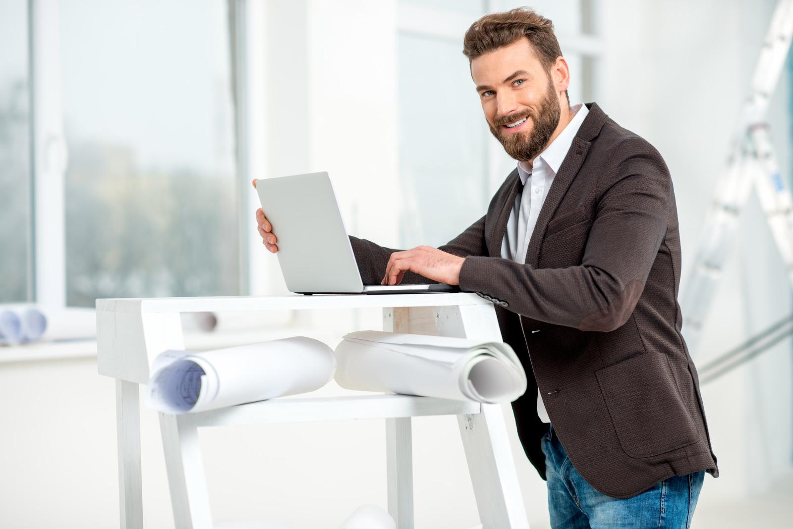 Architect or designer working on laptop - email migration